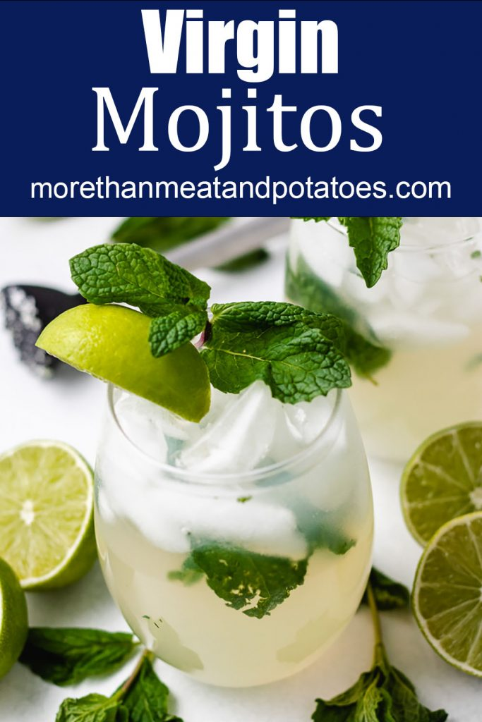 Mojito in a glass with lime wedge and mint.