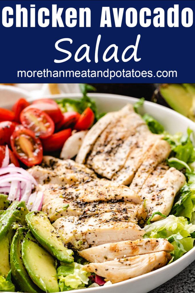 Sliced chicken on salad.
