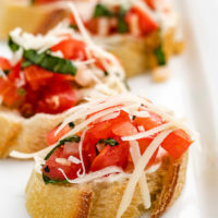 Close up of bruschetta on baguette slices.