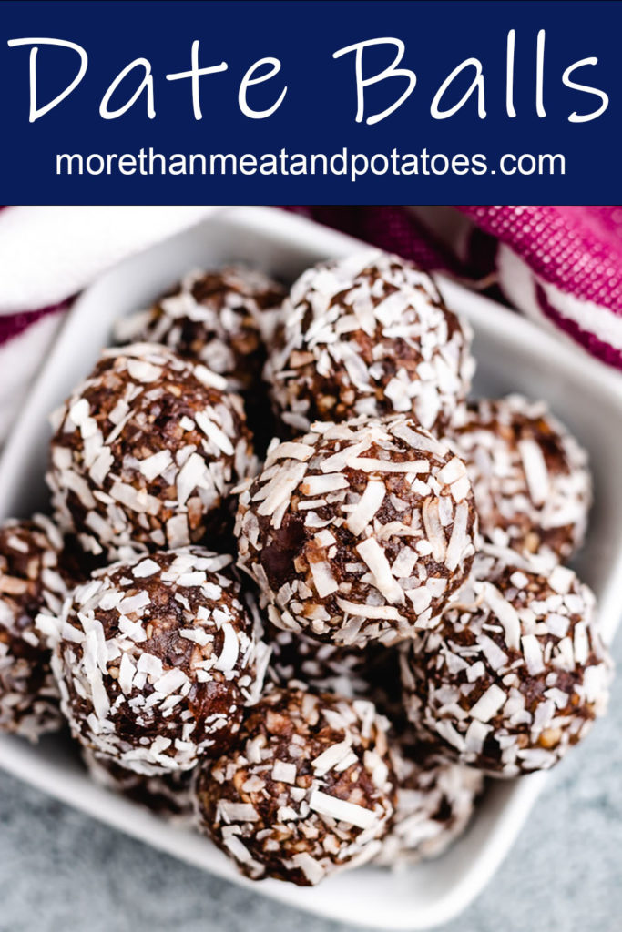 Close up of chocolate date balls in a dish.