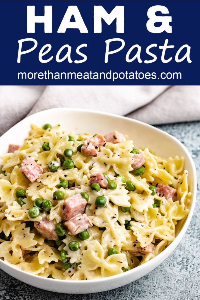 Ham and peas pasta in a white bowl.