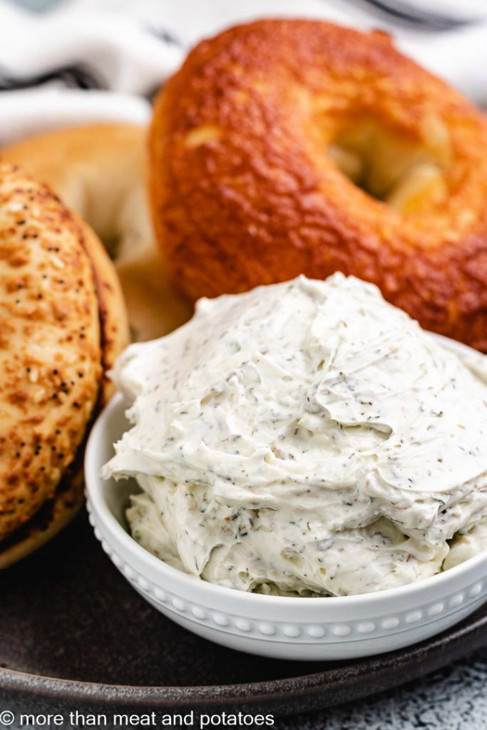 Small bowl of cream cheese with bagels.