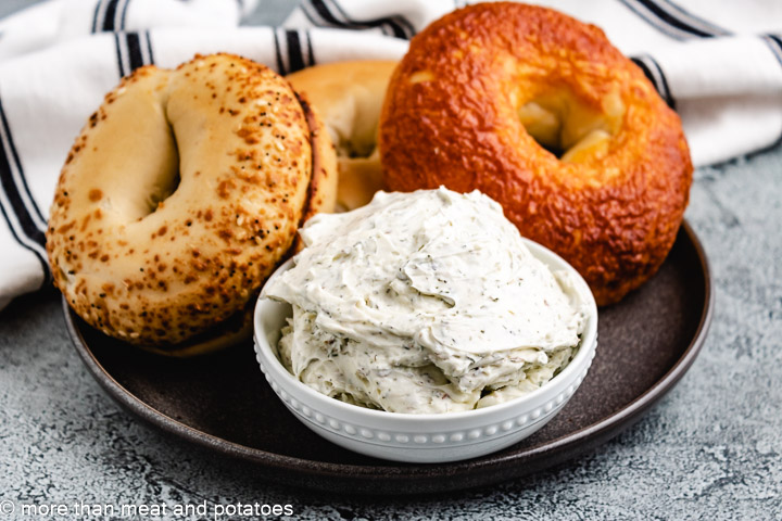 Herb and garlic cream cheese with bagels.