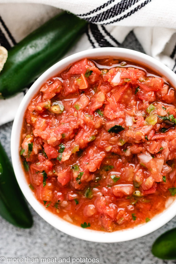 Top down view of chunky salsa in a serving bowl.