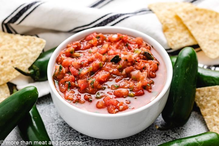 Homemade salsa recipe in a white bowl.