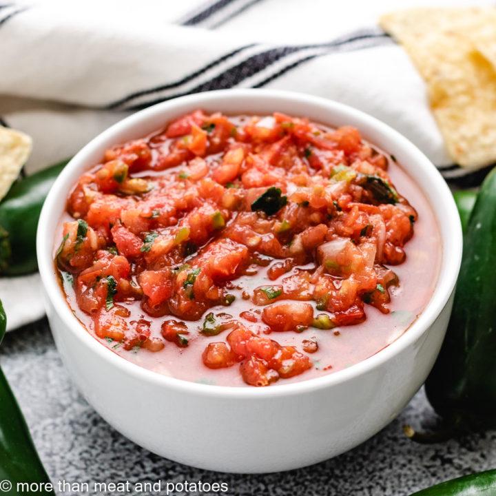 Fresh tomato salsa in a white bowl.
