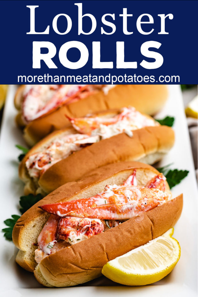 Four lobster rolls on a white plate.