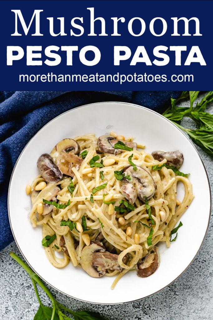 Top down view of mushroom pesto pasta with mushrooms and pine nuts.