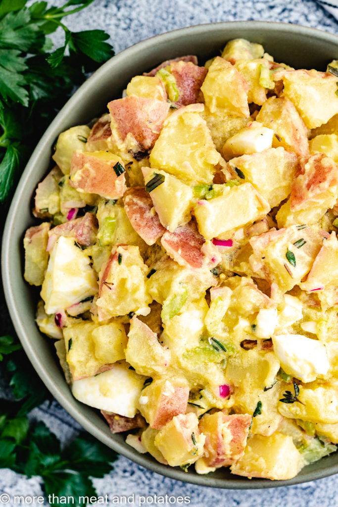 Top down view of red skinned potato salad.