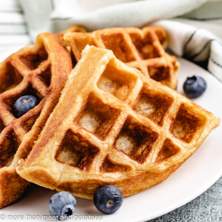 Sourdough waffles with blueberries on a plate.