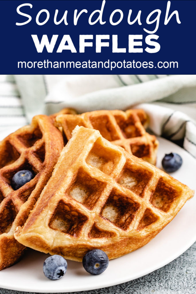 Hot waffles with fruit and a napkin.