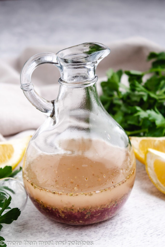 Salad dressing in a glass container.