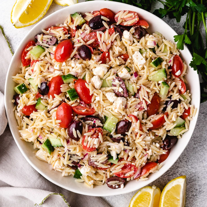 Top down view of orzo salad in a dish.