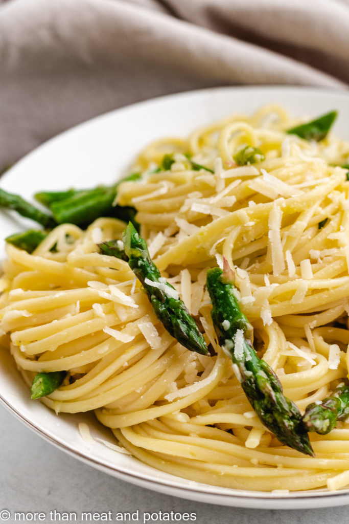 Close up of lemon linguine in a white dish.
