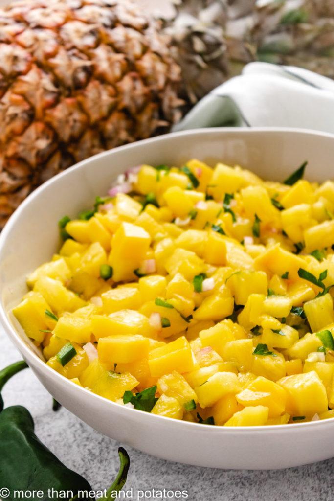 Mango pineapple salsa in a gray dish.