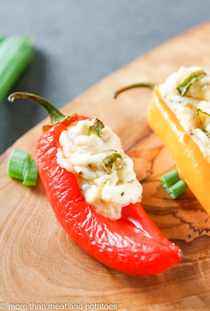 Mini red pepper filled with cream cheese.