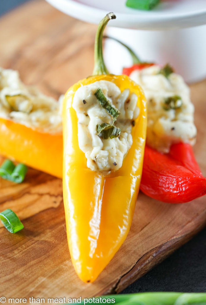 Pepper filled with cream cheese and green onions.