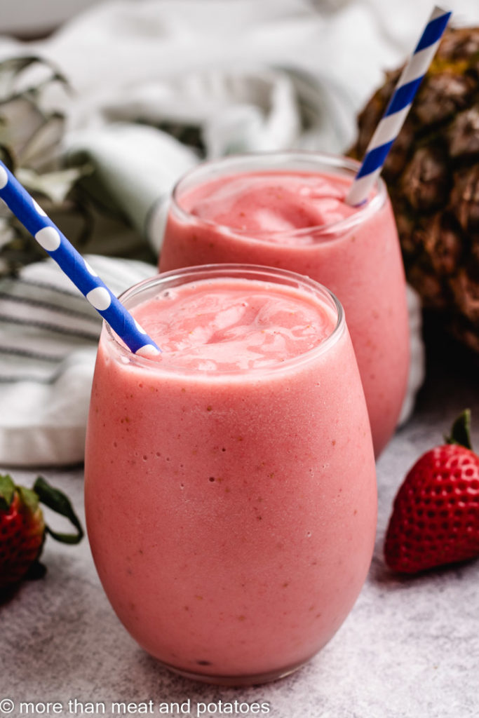 Two glasses of strawberry and pineapple smoothie.