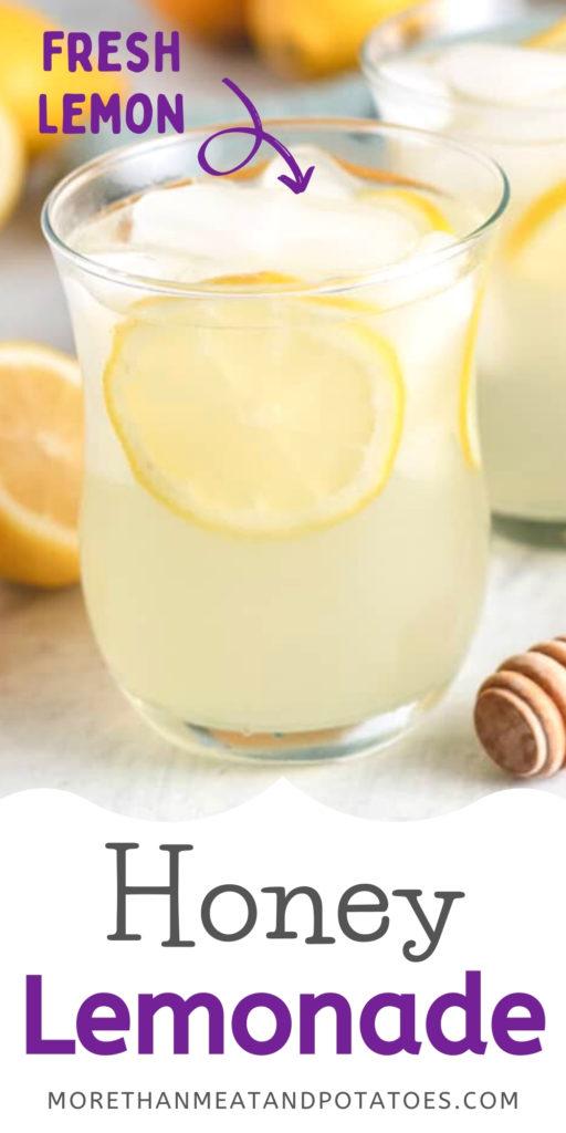 Glass of honey lemonade with fresh lemon slices.