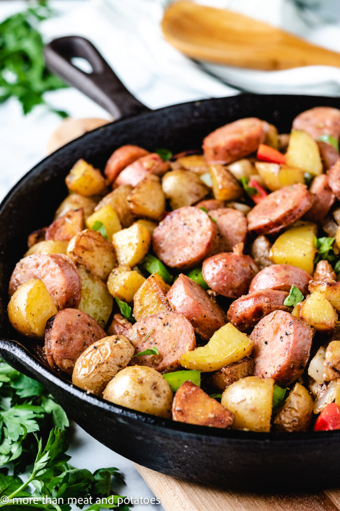 Sausage potatoes and peppers in cast iron.