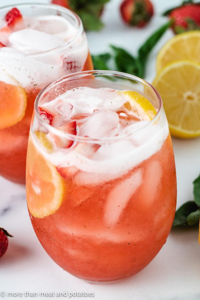 Strawberry lemonade with fresh basil and slices of lemon.