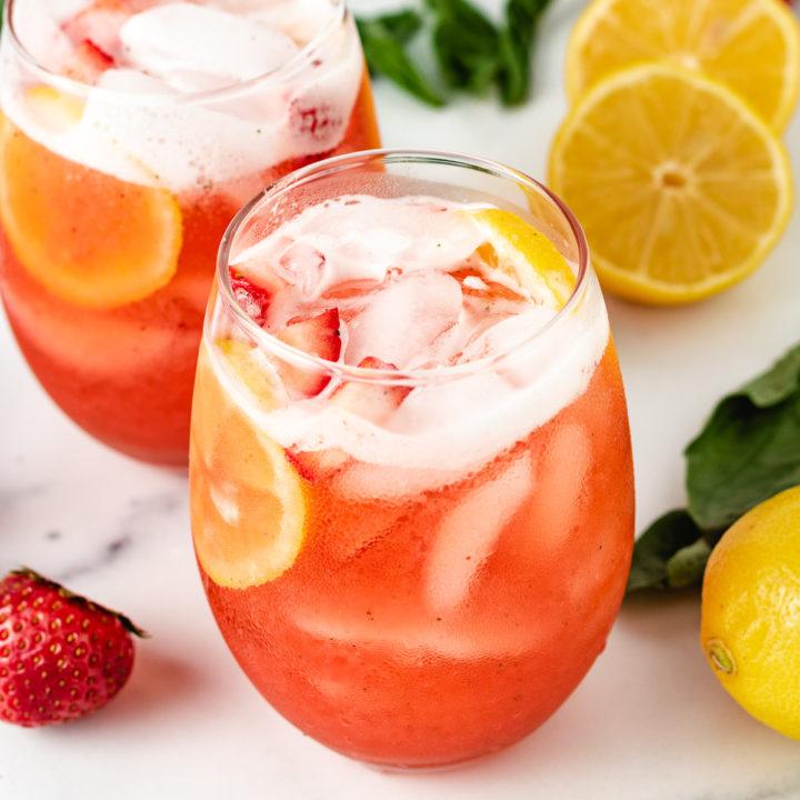 Strawberry basil lemonade in two glasses.