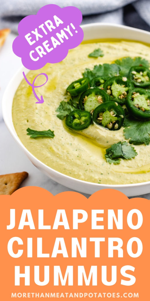 Large bowl of hummus topped with jalapenos and cilantro.