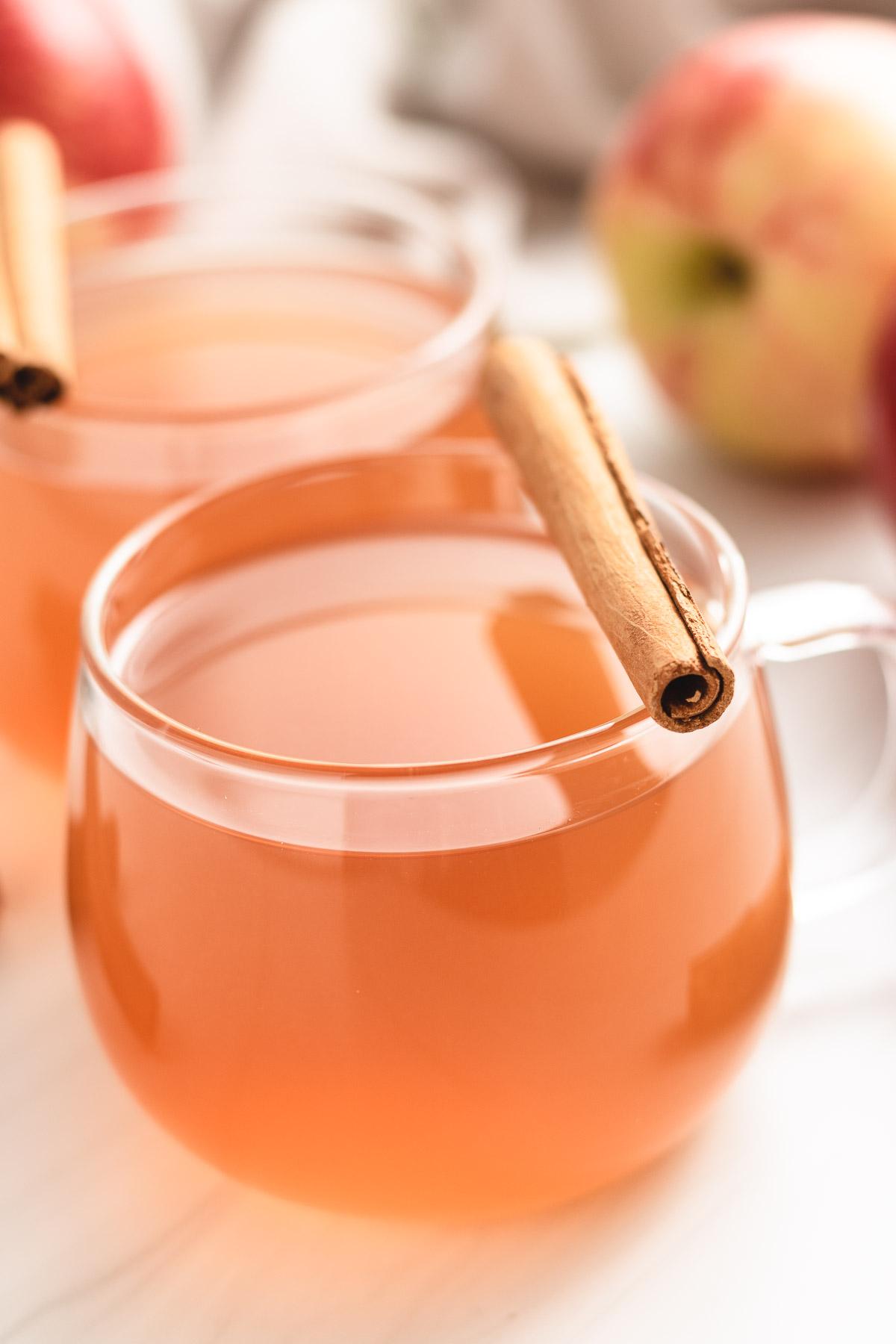Apple cider in a glass mugh.