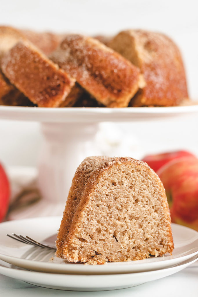 Piece of apple cider donut cake on a plate.