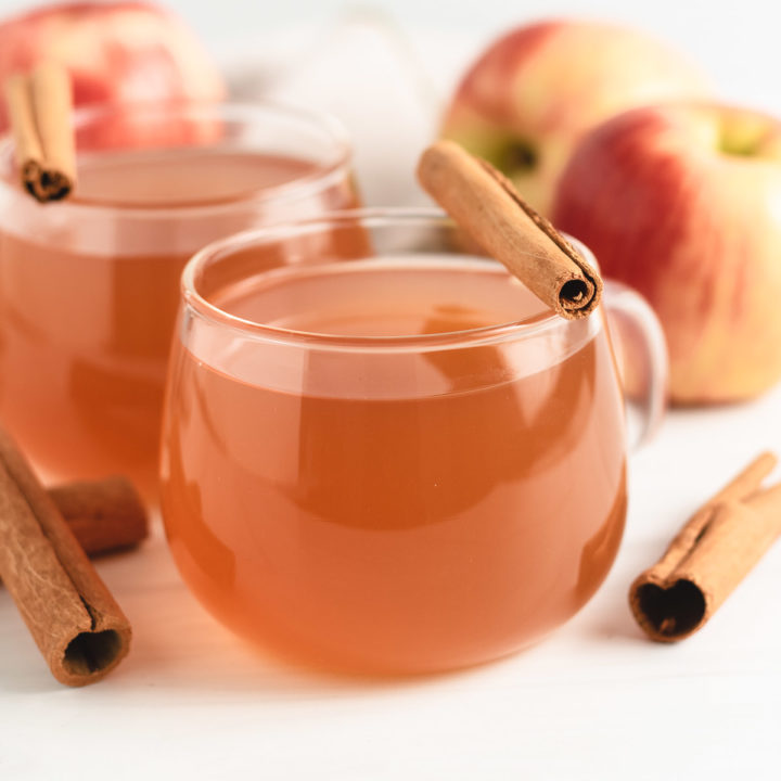 Two cups of fresh apple cider.