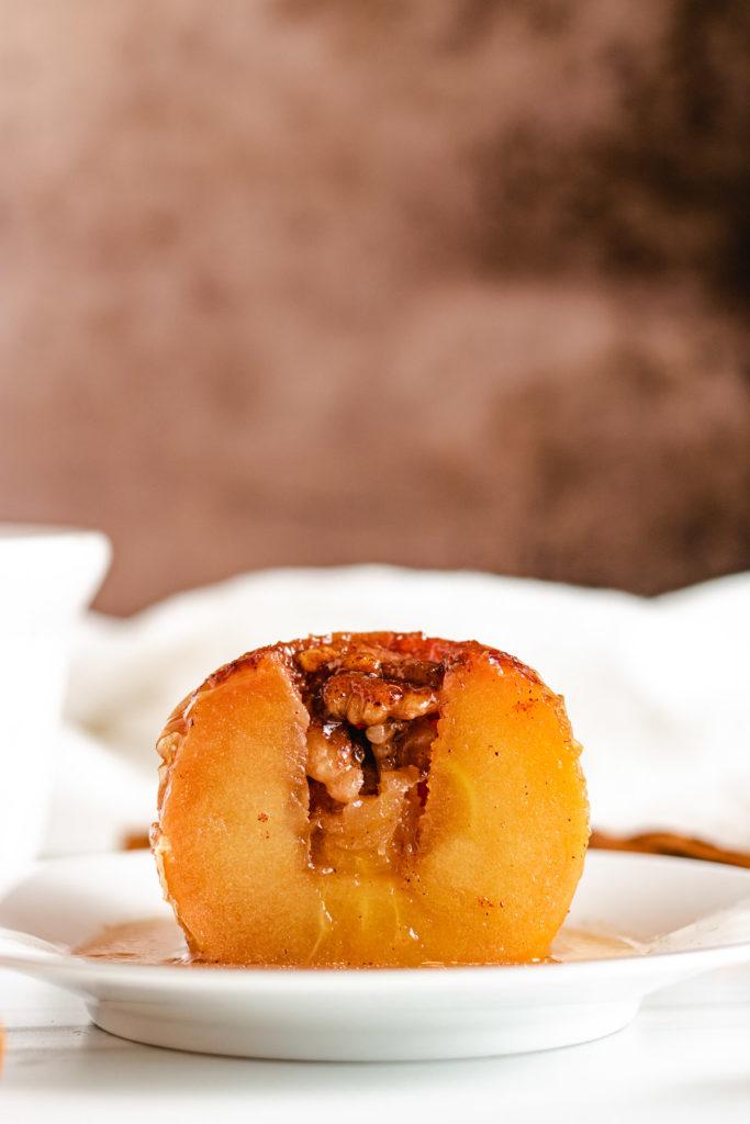 Baked apple sliced in half.
