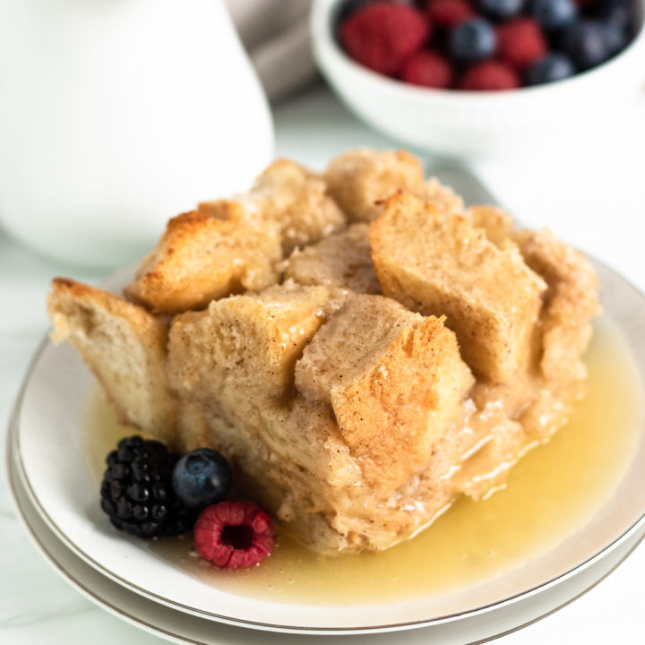 Berries and bread pudding on plates.