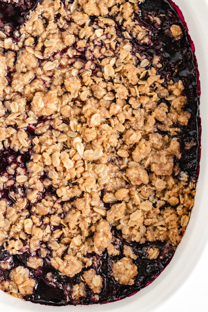 Top down view of blueberry crisp in a baking dish.