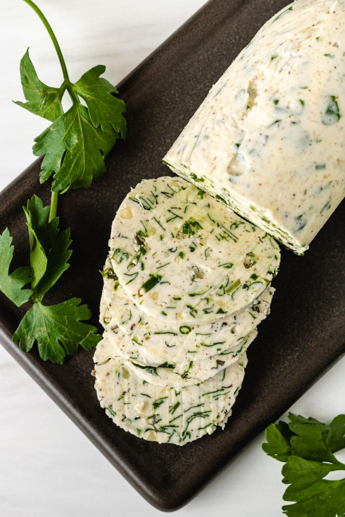 Top down view of fresh herb butter.