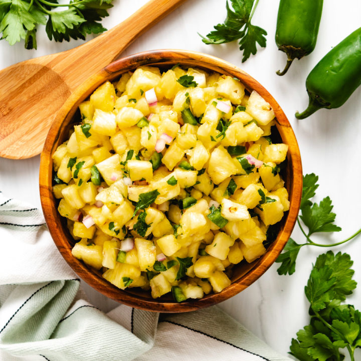 Top down view of jalapeno salsa with diced pineapple.