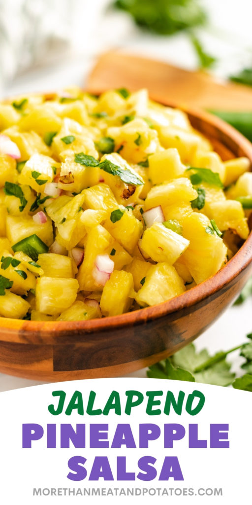 Pineapple salsa in a wooden bowl.