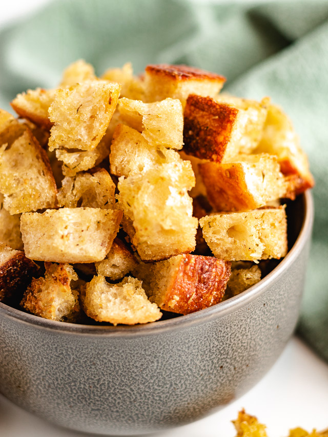 Croutons in a gray bowl.
