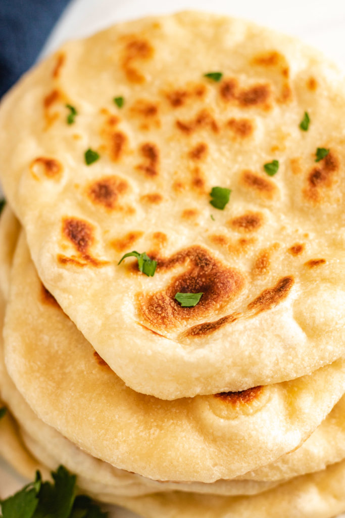 Naan bread with fresh parsley.