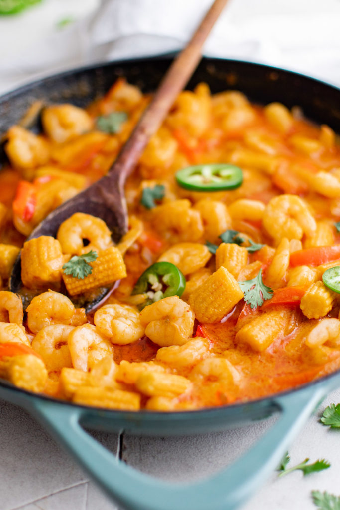 Shrimp curry in a skillet.