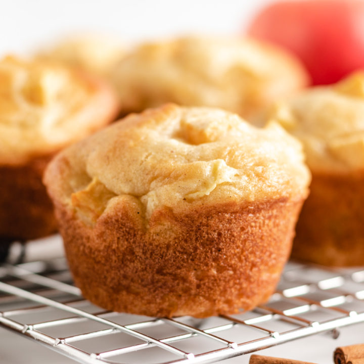 Apple cinnamon muffins on a wire rack.