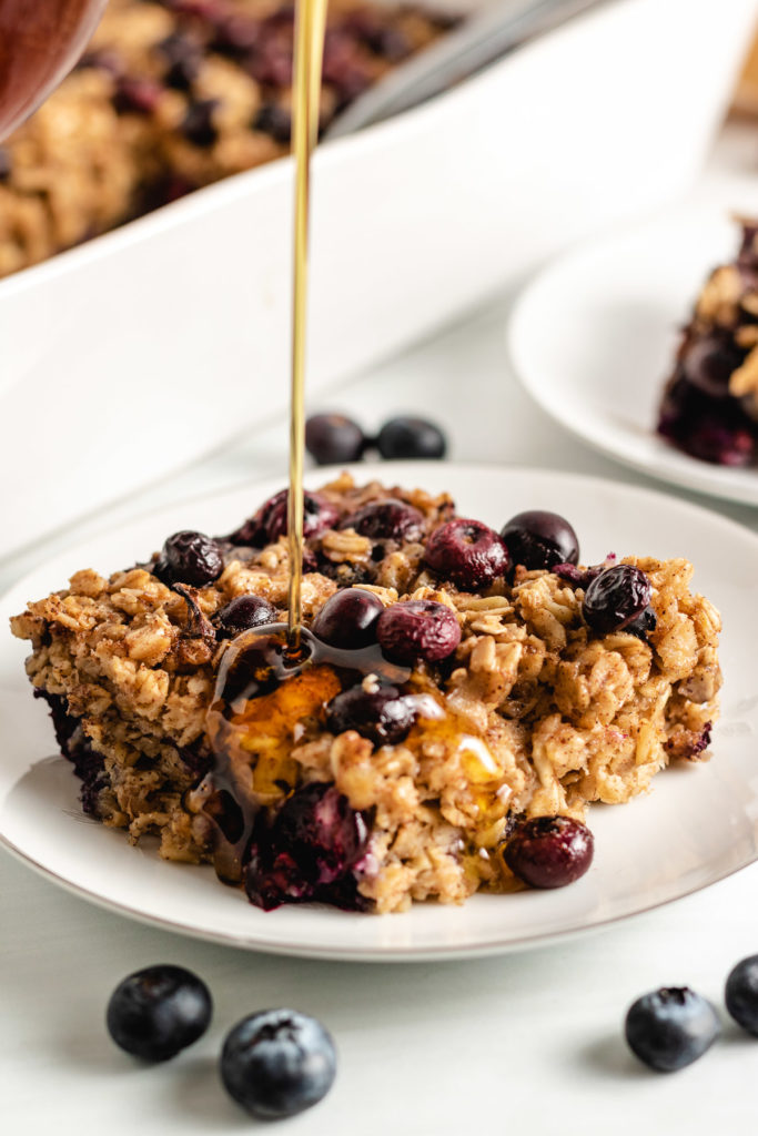Baked oatmeal with syrup on a plate.