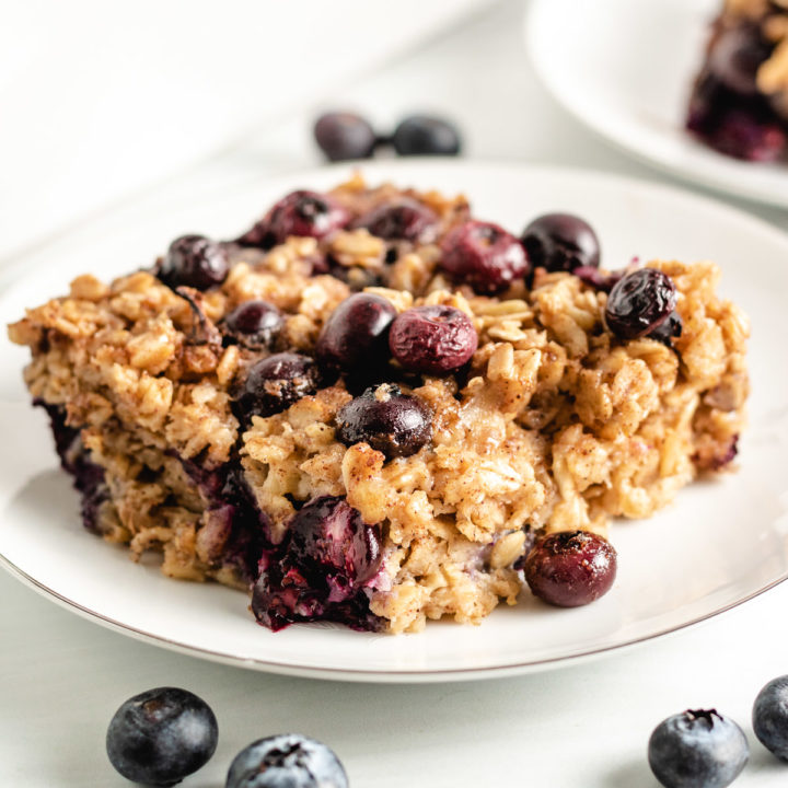 Baked blueberry oatmeal on a plate.