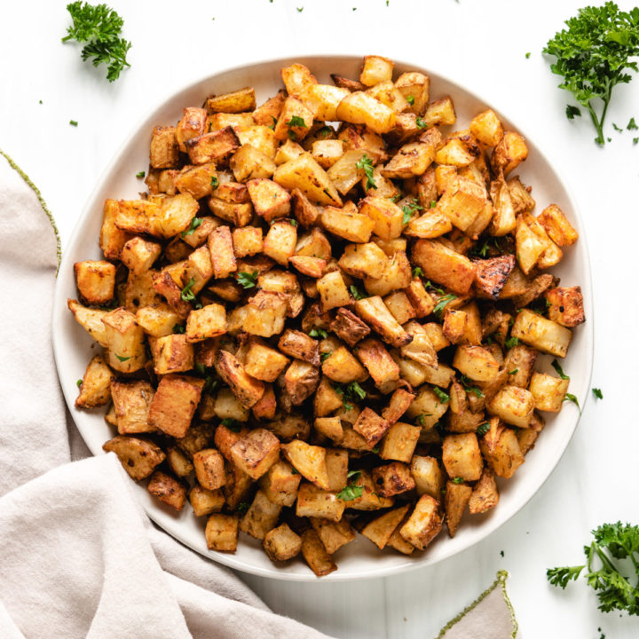 Top down view of a plate of roasted potatoes.